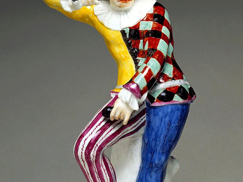 An angry harlequin figurine