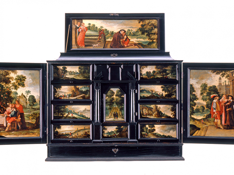 A Flemish cabinet depicting the tale of the Prodigal Son