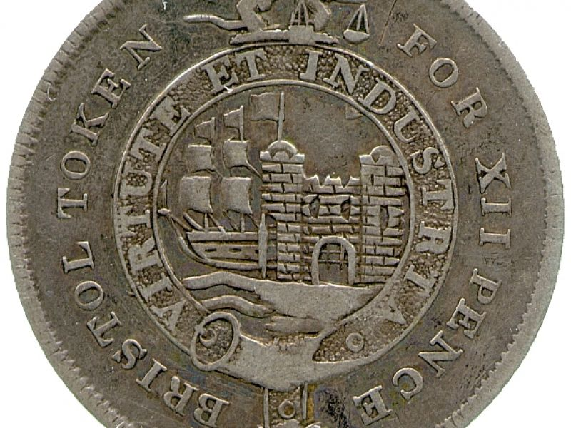 Obverse of a 19th-century silver shilling token of Bristol, Queens' College Collection, CM.QC.4014-R