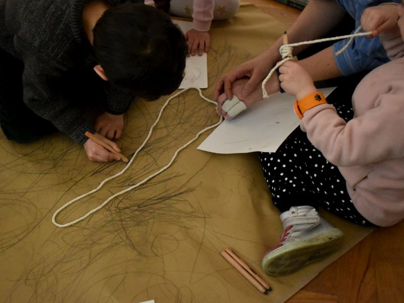 Children drawing in a gallery in response to Degas' work