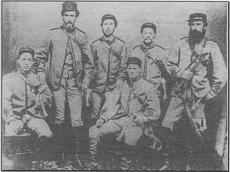 Photograph of a group of the Taranaki Mounted Volunteers, 1863 or 1864